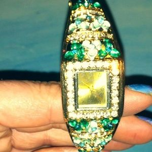 Gold with green and clear diamond cut crystals
